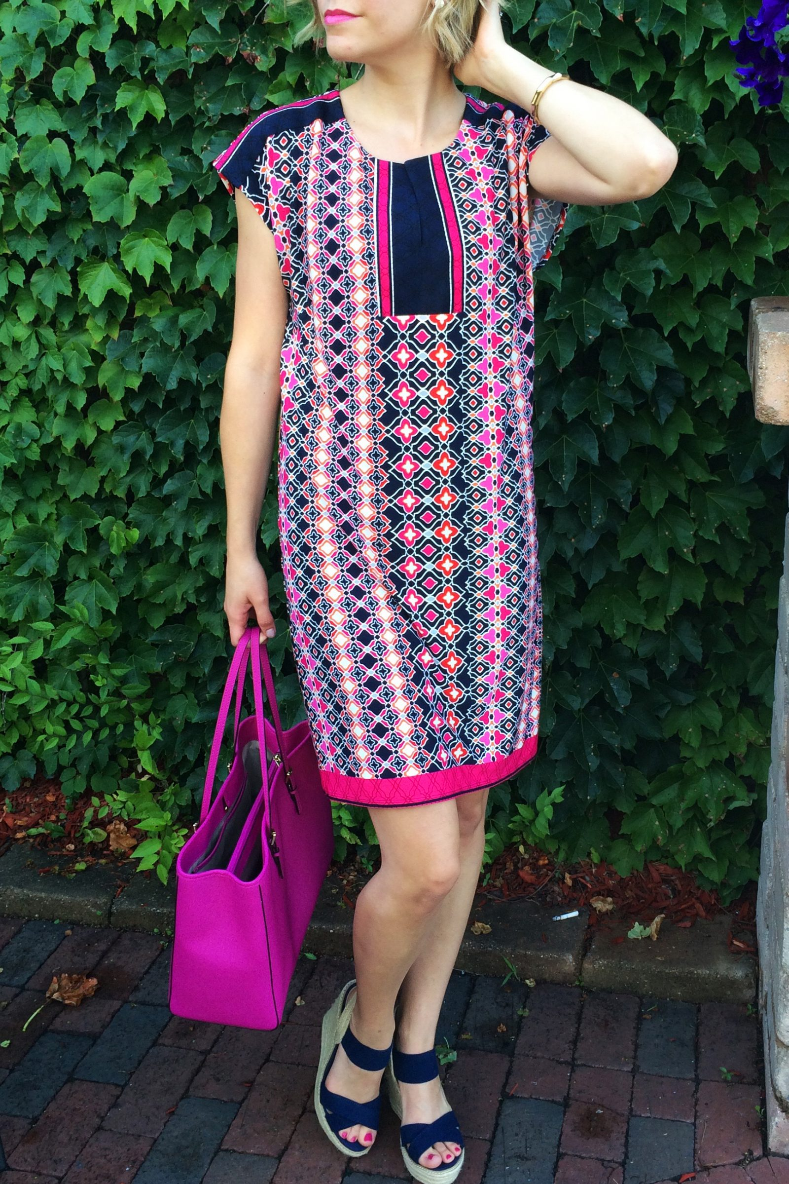 Bright pink and navy blue shift dress. Pattern dress. Steve Madden wedges, Michael Kors Purse. Find more great outfit ideas at Embellishmints.com