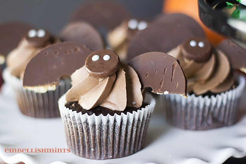 Halloween Bat Cupcakes are so fun and cute. Perfect for your next party, neighborhood treats and an impressive treat for co-workers. Find step-by-step instructions at www.Embellishmints.com