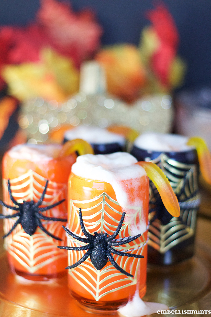 This Halloween Party Punch Recipe is the perfect drink for any get together. Add gummy worms for Halloween, or peach gummies for a Spring or Summer Party! www.Embellishmints.com