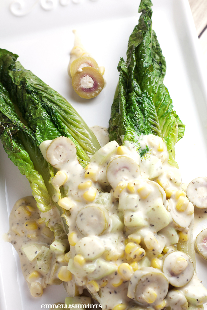 Grilled Romain Caesar Salad with Zesty Lime Ceasar Dressing. Perfect for large friend and family parties. Find the recipe at www.Embellishmints.com