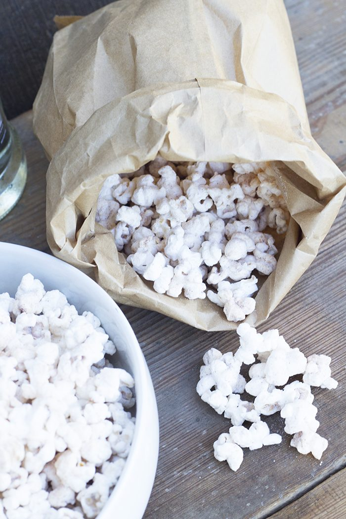 Churro Popcorn is so easy to make and it's dangerously good!! It's a great homemade gift for friends and family. Quick, easy and delicious! www.Embellishmints.com