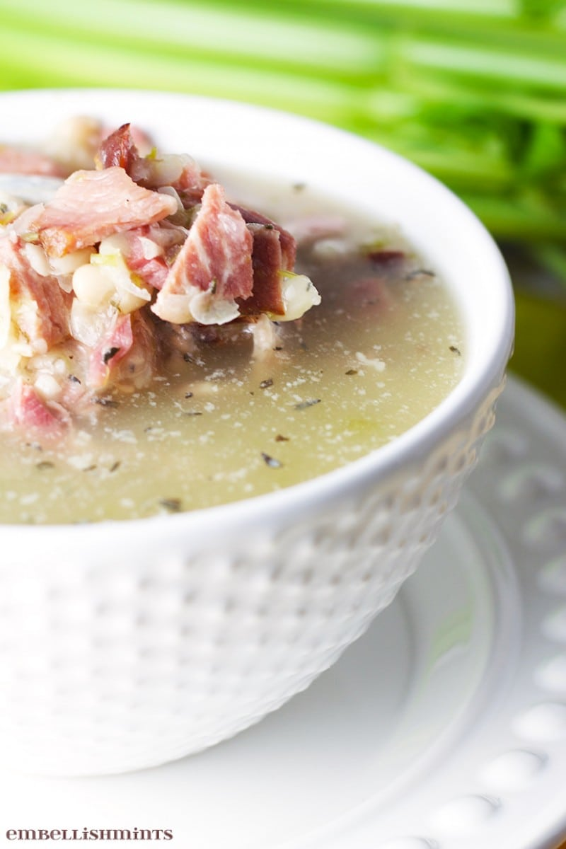 This Ham and Bean Soup Recipe is perfect for leftover ham any time of year! It's a delicious low-fat soup full of flavor! www.Embellishmints.com