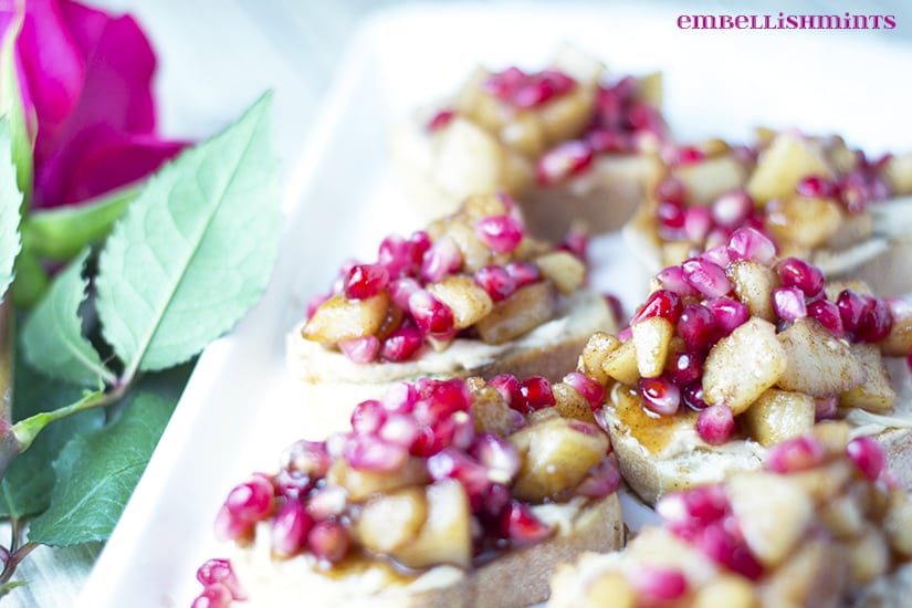 Spiced Pear and Pomegranate Crostini. This diced pears and pomegranate arils recipe make the perfect appetizer. The delicious cinnamon maple sauce helps balance out the sweetness with a touch of balsamic vinegar. Get the recipe at www.embellishmints.com