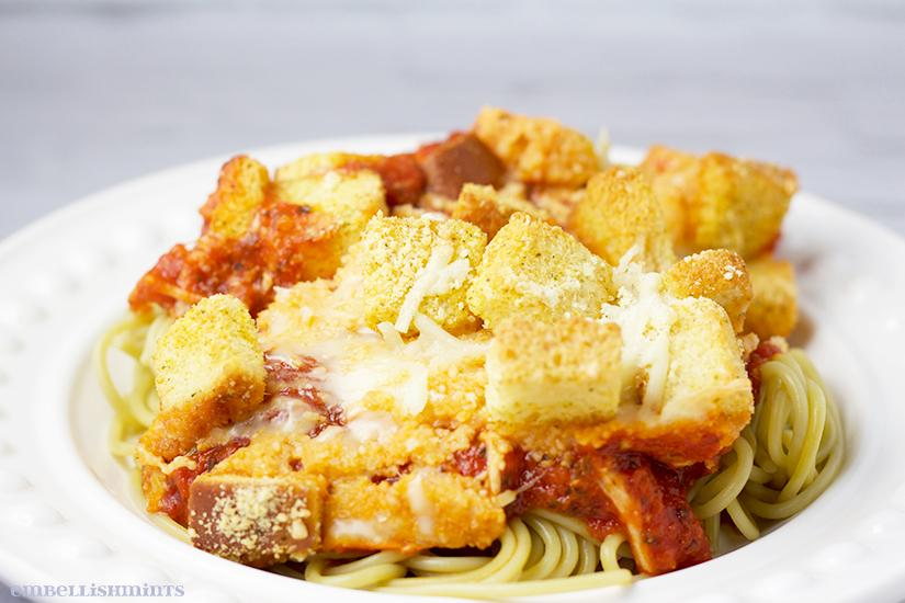 Chicken Parmesan Casserole is ready in 30 minutes or LESS! You are going to love this recipe. It's delicious and so easy. Find the recipe on www.Embellishmints.com