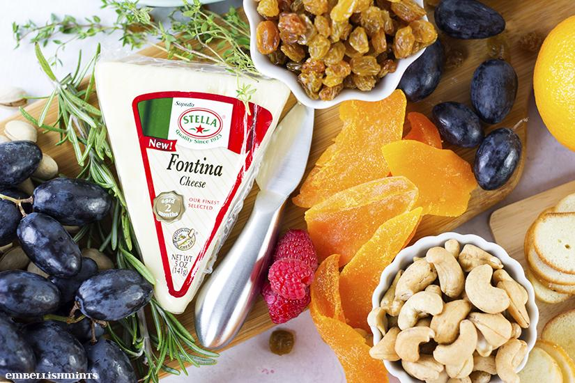 The fruit and cheese board! An absolute party staple. They are simple to put together and they can upgrade your table spread tenfold. Trust me. Find all the inspiration you need here at www.Embellishmints.com