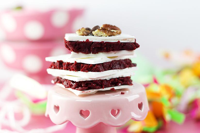 Red Velvet Truffle Bars taste just as amazing as Red Velvet Cake Balls but take half the time and don't require nearly as much skill. Find out how to make this and other delicious dessert recipes on Embellishmints.com