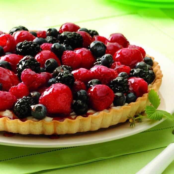 My favorite from this week's Linky Party! This Fresh Mixed Berry Tart Recipe will make you excited for the warm days of summer! Fresh berries really make it pop! Get the link to the recipe here.