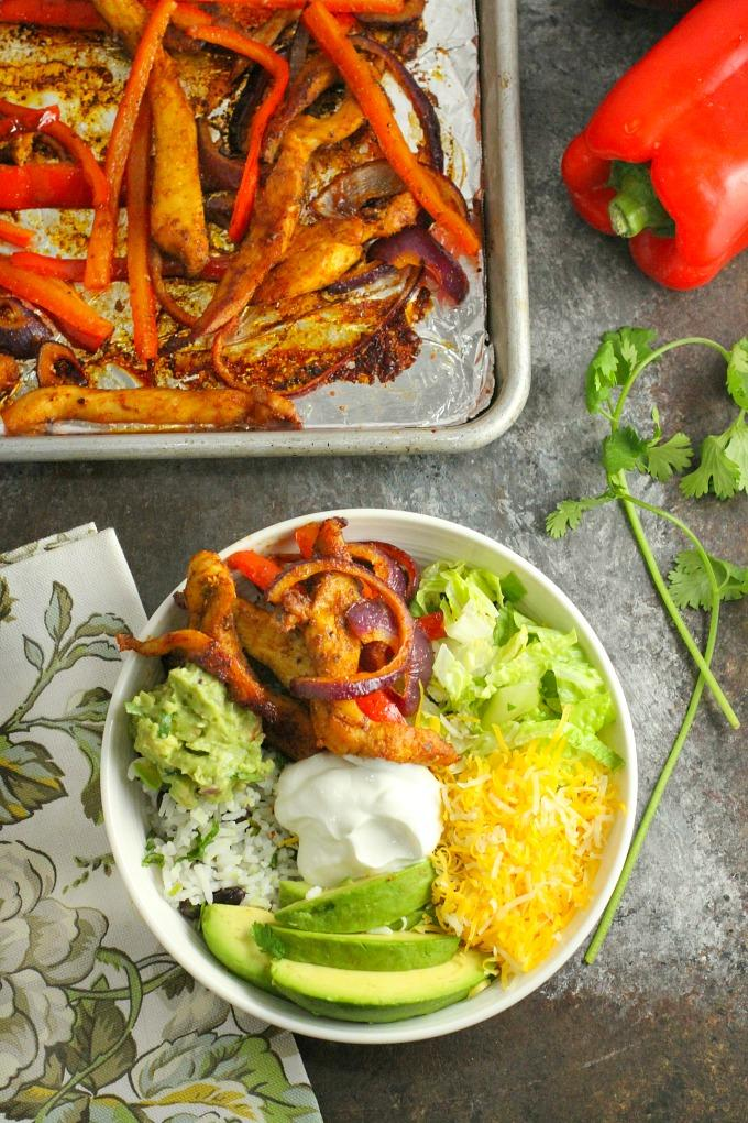 Chicken Fajita Bowls // Sheet Pan Fajitas. A great way to get those veggies in! This week's favorite from our linky party on www.Embellishmints.com
