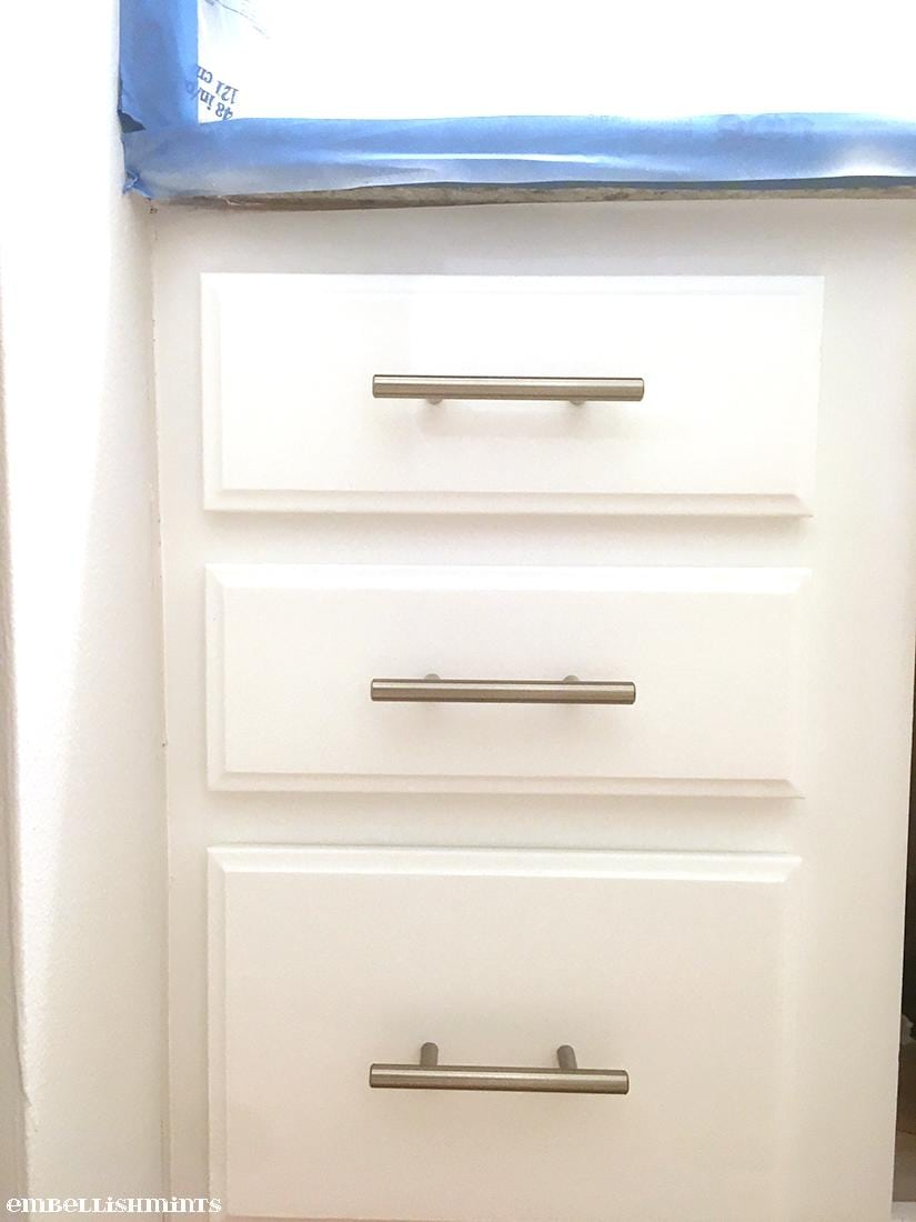 How To Paint Cabinets White. Learn how to refinish your cabinets in a weekend. Transform your old and tired cabinets with fresh paint and new hardware. www.Embellishmints.com